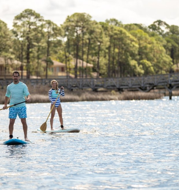 A couple on a stand-up paddleboard