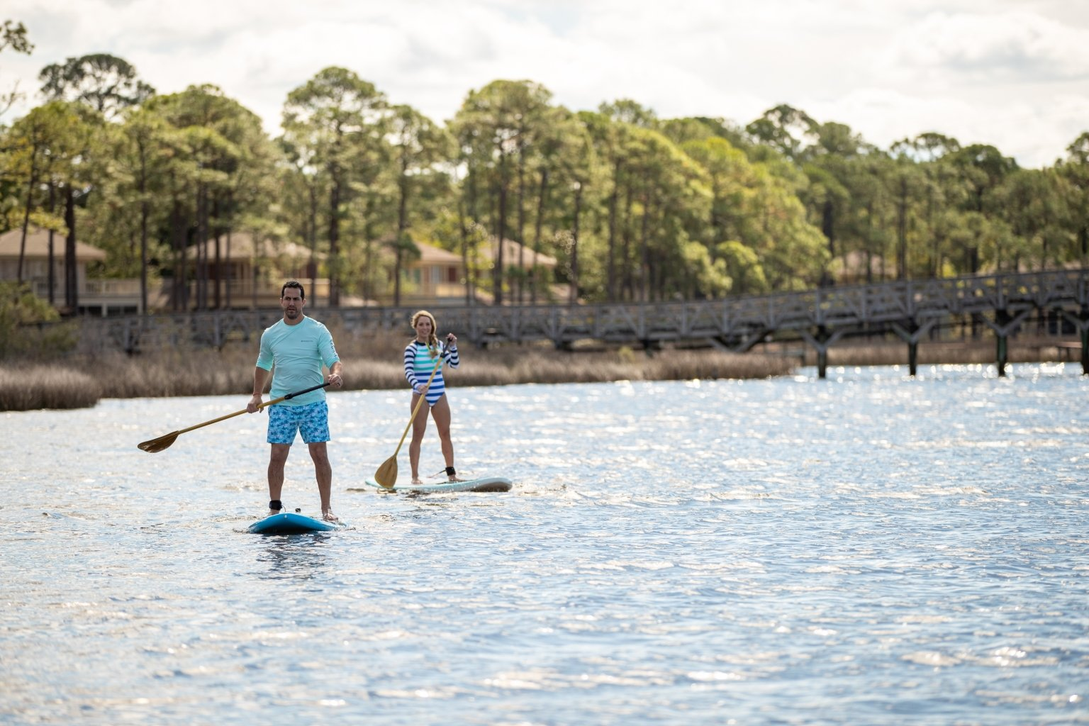 a couple paddleboarding