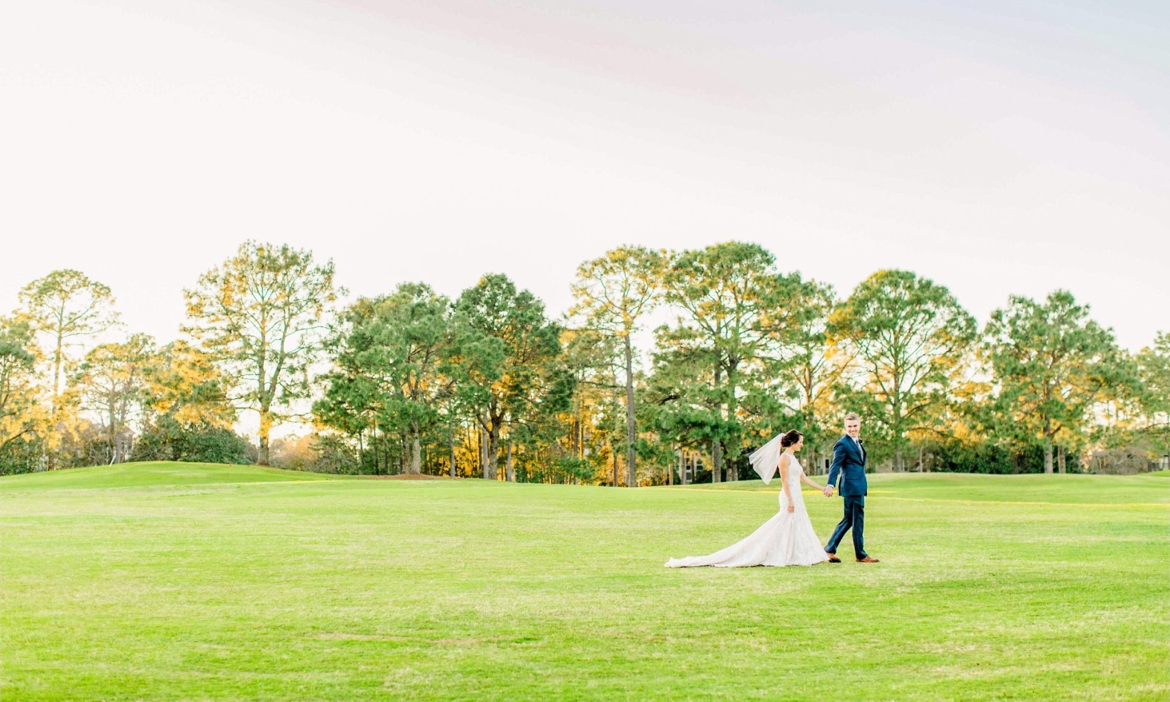 A bride and groom on the lush green grass at hotel effie