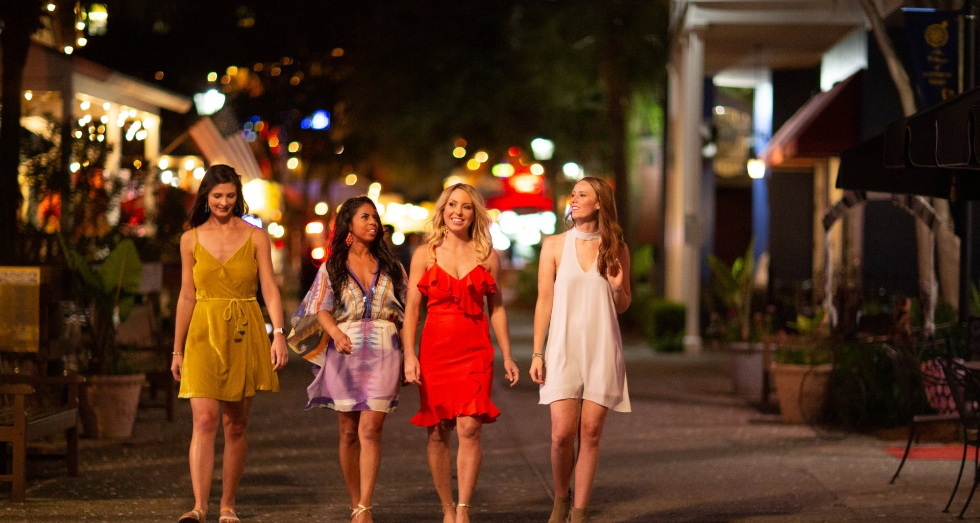 Four women strolling the streets at Baytowne Wharf