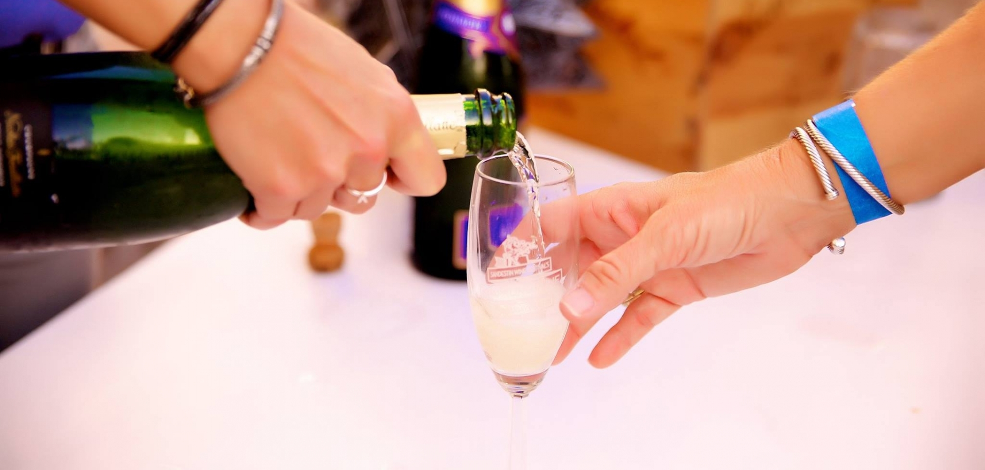 Woman pouring a glass of sparkling wine