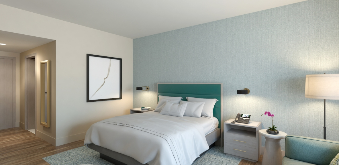 A bed with a blue headboard, two side tables, and some modern artwork on the wall.
