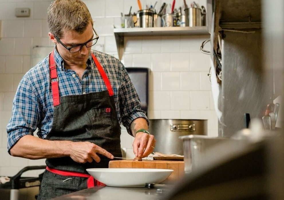 Chef Hugh Acheson in Kitchen Preparing a Meal